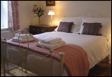 relax in one of our three beautifully decorated bedrooms